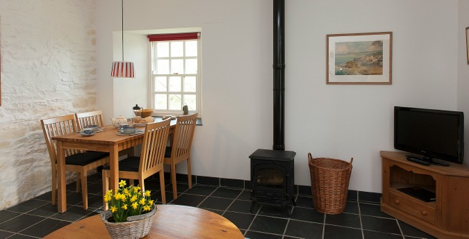 The dining table of Rose Cottage - a pet friendly holiday cottage at Rosemoor in Pembrokeshire, South West Wales
