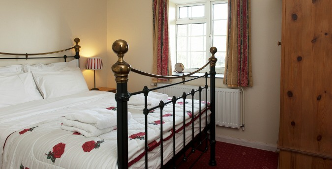 Double bedroom of Rose Cottage - a pet friendly holiday cottage at Rosemoor in Pembrokeshire, South West Wales