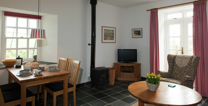 Living room of Rose Cottage - a pet friendly holiday cottage at Rosemoor in Pembrokeshire, South West Wales
