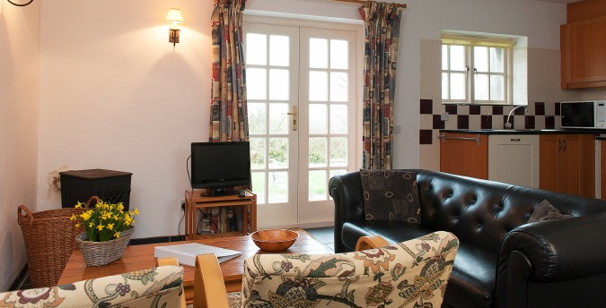Living room of Peace Cottage - a pet friendly holiday cottage at Rosemoor in Pembrokeshire, South West Wales