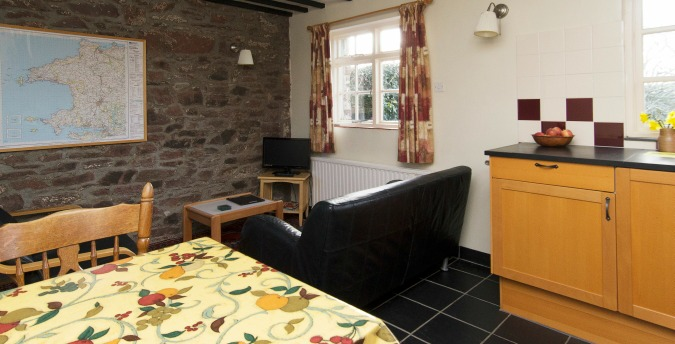 Living room of Spring Cottage - a pet free holiday cottage at Rosemoor, Pembrokeshire, South West Wales
