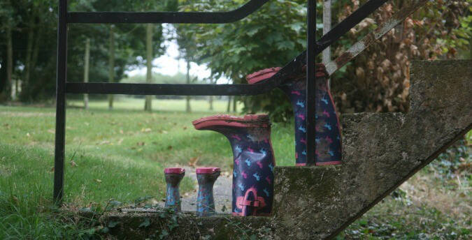 Wellies on the steps to a holiday cottage, Rosemoor, Pembrokeshire, South West Wales