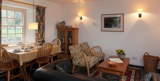 Dining living room of Peace Cottage - a pet friendly holiday cottage at Rosemoor in Pembrokeshire, South West Wales