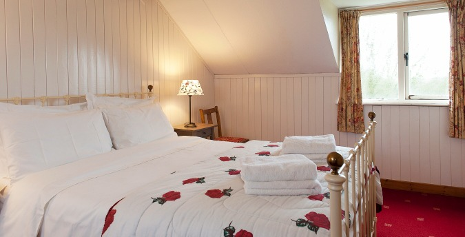 Double room of Peace Cottage - a pet friendly holiday cottage at Rosemoor in Pembrokeshire, South West Wales