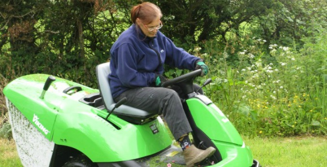 Cutting the grass, Jan and Jaqui, luxury holiday cottages in pembrokeshire, dog friendly cottages west wales